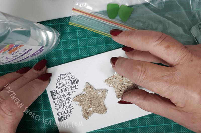 glue the sandy stars onto Christmas card