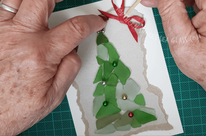 add bow to Christmas tree card