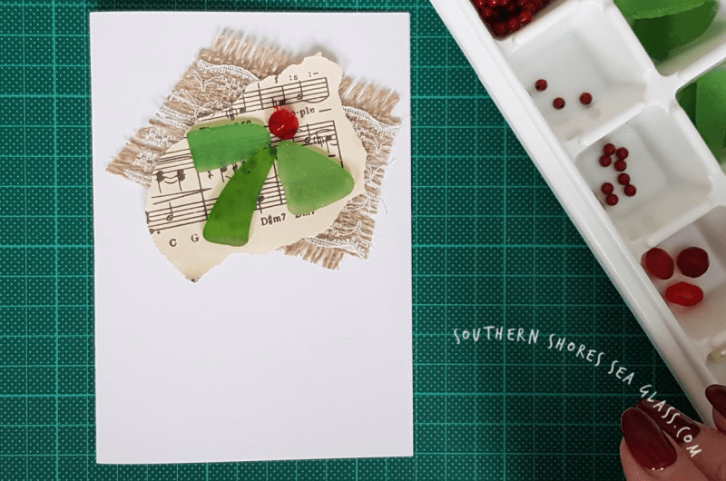 adding sea glass and bead to the Christmas holly card